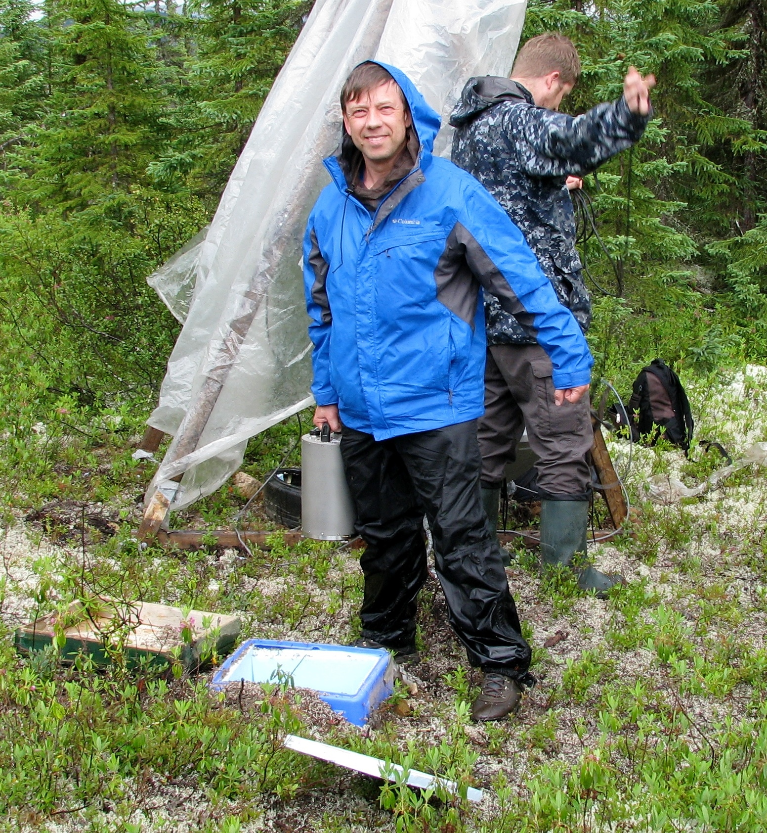 Professor Vadim Levin (front) and Rutgers Geology major Michael Klaser recover a portable seismic observatory in the woods in central Quebec. Photo: Courtesy of Vadim Levin/Rutgers University-New Brunswick