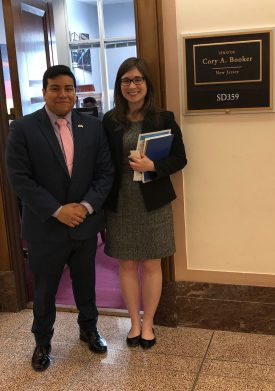 Johnny Quispe with Ariana Spawn, legislative aide, outside Sen. Booker's office.