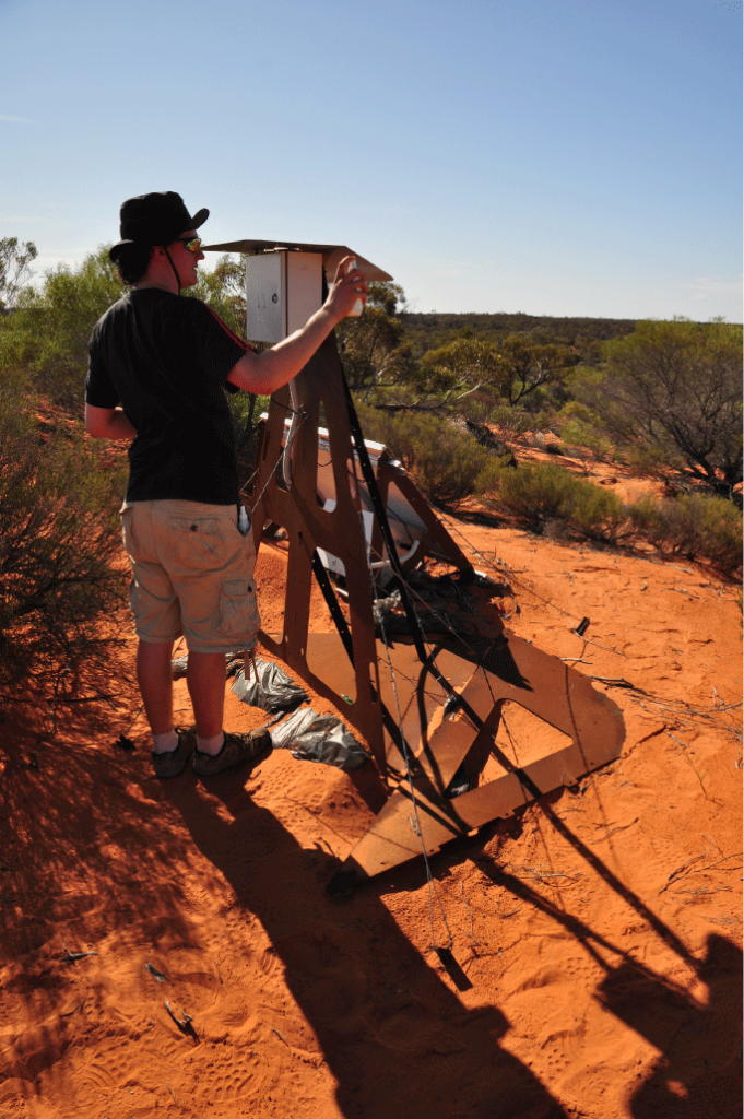 Luke Daly adding the finishing touches to a new camera. Credit: Desert Fireball Network, Curtin University