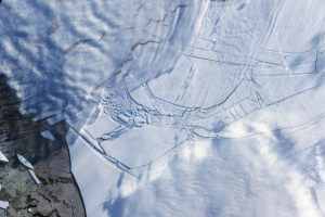 If Paris Agreement targets are not met, the collapse of melting Antarctic ice shelves – like the Wilkins Ice Shelf in 2009 – could cause catastrophic global sea level rise in the second half of the century. Image: NASA