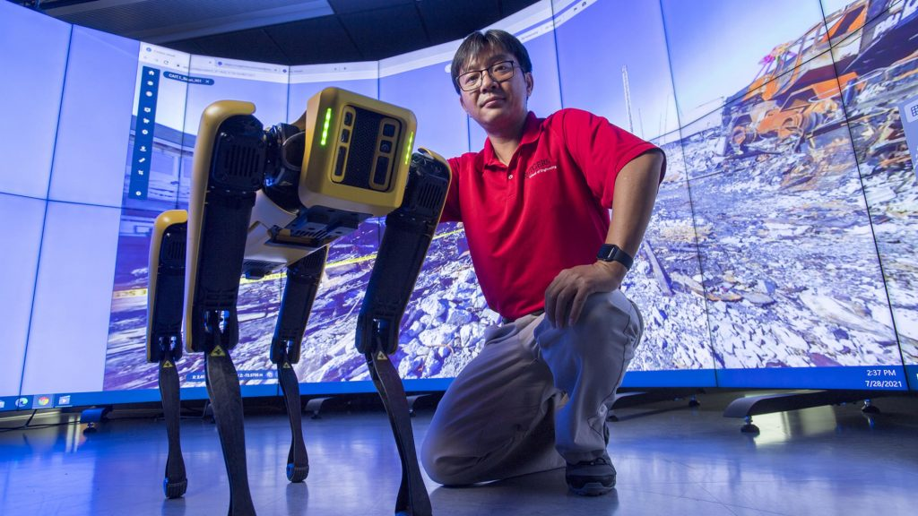 Jie Gong with his robot